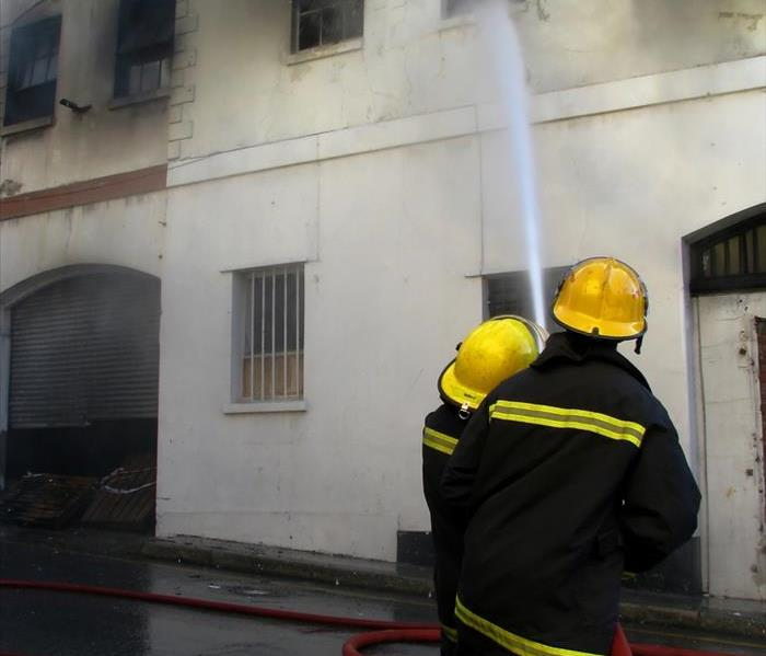 Firefighters putting out fire in an old building